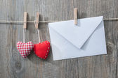 Message and red hearts on the clothesline — Stockfoto
