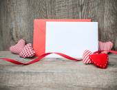 Envelope with red hearts — Stock Photo
