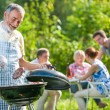 Family having a barbecue party — Stock Photo #66144061