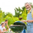 Family having a barbecue party — Stock Photo #66144101