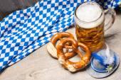 Bavarian beer mug and pretzels — Stock Photo