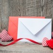 Envelope with red hearts — Stock Photo #67429617