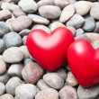 Two red hearts on pebble stones — Stock Photo #67429973