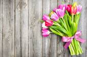 Spring tulips on old wooden background — Стоковое фото