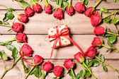 Frame of fresh roses with a gift box — Foto de Stock