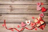 Gift box with red ribbon with textile hearts — Stock Photo