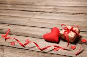 Heart and gift box with red ribbon — Stock Photo