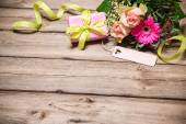 Bunch of flowers with an empty tag — Stock Photo