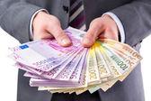 Podnikatel s penězi v ruce — Stock fotografie