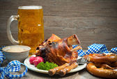 Roasted pork knuckle with pretzels and beer. — Stock Photo