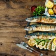 Grilled mackerel fish with baked potatoes — Stock Photo #78699752