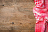 Tablecloth on wooden table — Stock Photo