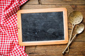 Blackboard with tablecloth — Stock Photo