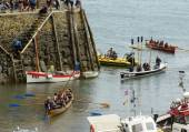 Rowing boats traffic at harbour entrance at Clovelly, Devon — Stock Photo