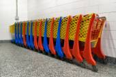 Row of colorful shopping trolley in supermarket — Stock Photo