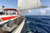 Sail boat navigating on the waves — Stock Photo