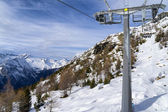 Mountain slopes and chairlift in winter on a sunny day — Stock Photo