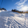 Ski lift over slopes in mountain with paths from skies and snowboards — Stock Photo #63786317