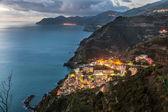 Riomaggiore and Cinque Terre coastline from above at sunset, Liguria, Italy — Stock Photo