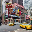 NEW YORK CITY - JUNE 15, 2015: Yellow cabs in Broadway, a busy tourist intersection of commerce Advertisements and theaters. One of the most famous streets of New York City and US — Stock Photo #75468059