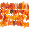 Beads of raw amber as abstract background — Stock Photo #53199353