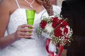 Wedding bouquet with roses and a glass of champagne — Stock Photo