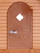 Entrance door of plastic house toy close up — Stock Photo