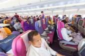 BANGKOK, THAILAND - OCTOBER 27: flight crew and passengers on bo — Stock Photo