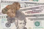 US coins on US banknotes close up — Stock Photo