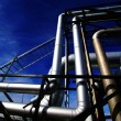 Pipes, bolts, valves against blue sky in blue tones — Stock Photo #62321911