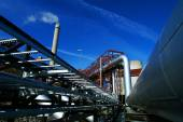 Pipes, tubes, smokestack at a power plant — Stock Photo