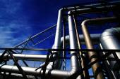 Pipes, bolts, valves against blue sky in blue tones — Stock Photo