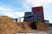 Bio power plant with storage of wooden fuel (biomass) against bl — Stock Photo