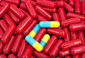 Red colorful capsules — Stock Photo