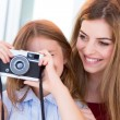 Girl shooting with a vintage camera — Stock Photo #51937527