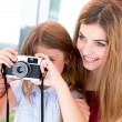 Girl shooting with a vintage camera — Stock Photo #51937603