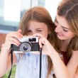Girl shooting with a vintage camera — Stock Photo #51937645
