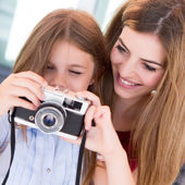 Girl shooting with a vintage camera — Stock Photo