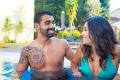 Couple in pool — Stock Photo