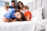 Family in bed — Stock Photo