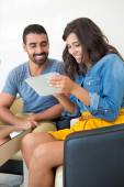 Couple using tablet — Stock Photo