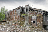 Rubble with demolished building — Stock fotografie