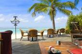 Tropical restaurant by the ocean — Stock Photo
