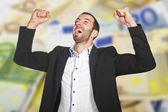 Young businessman celebrates win — Stock Photo
