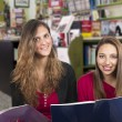 Girls in library — Stock Photo #68147687