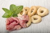 Taralli with sliced ham — Stock Photo