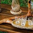 Bough wood wicker tray and glasses — Stock Photo #54025427
