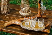 Bough wood wicker tray and glasses — Stock Photo