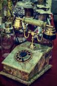 Old photo with old telephone in marble casing — Stock Photo