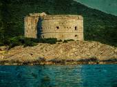 Old photo with a medieval fortress on the coast of Dalmatia — Stock Photo